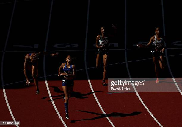 Allyson Felix first place Phyllis Francis second place and Natasha Hastings third place crossthe finishline in the Women's 400 Meters Final during...