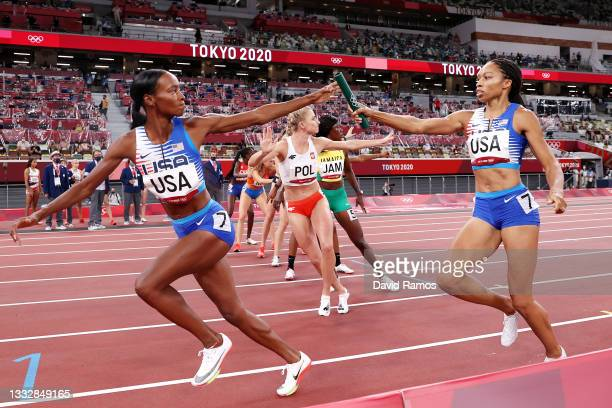Allyson Felix of Team United States passes the baton to teammate Dalilah Muhammad in the Women' s 4 x 400m Relay Final on day fifteen of the Tokyo...