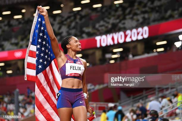 Allyson Felix of Team USA reacts after winning the bronze medal in the Women's 400m Final on day fourteen of the Tokyo 2020 Olympic Games at Olympic...