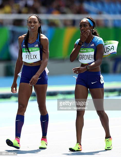 Allyson Felix of the United States and English Gardner of the United States react during round one of the Women's 4 x 100m Relay on Day 13 of the Rio...