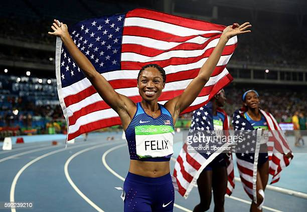 Allyson Felix of the United States celebrate winning gold in the Women's 4 x 100m Relay Final on Day 14 of the Rio 2016 Olympic Games at the Olympic...