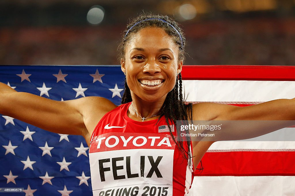 Allyson Felix of the United States celebrates after winning gold in the Women's 400 metres Final during day six of the 15th IAAF World Athletics Championships Beijing 2015 at Beijing National Stadium on August 27, 2015 in Beijing, China.