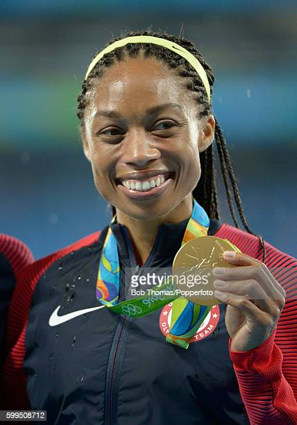 Allyson Felix of the United States celebrates with her gold medal during the medal ceremony for the Women's 4x400m Relay Final on Day 15 of the Rio...