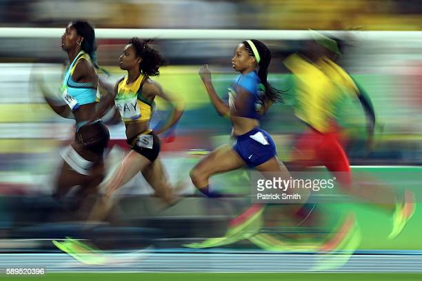 Allyson Felix of the United States Christine Day of Jamaica and Shaunae Miller of the Bahamas compete in the Women's 400 meter semifinal on Day 9 of...