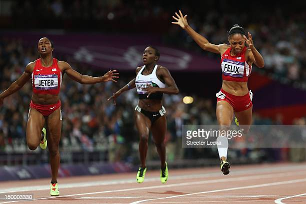 Allyson Felix of the United States crosses the finish line ahead of Murielle Ahoure of Cote d'Ivoire a and Carmelita Jeter of the United States to...