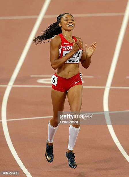 Allyson Felix of the United States crosses the line to win gold in the Women's 400 metres Final during day six of the 15th IAAF World Athletics...