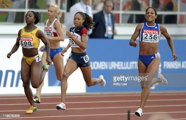 Allyson Felix of the United States holds off Christine Arron of France and Jamaica's Veronica Campbell to win the women's 200 meters in 2216 in the...