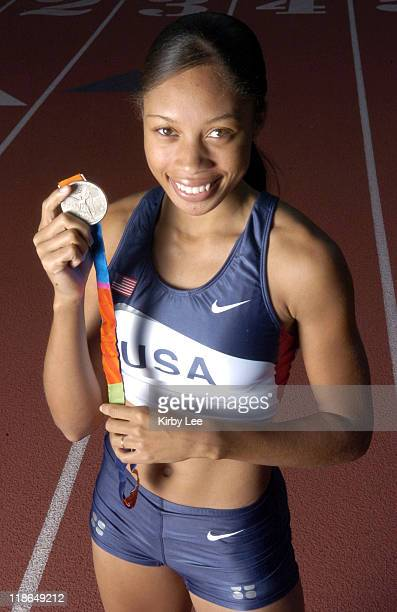 Allyson Felix of the United States poses with 2004 Athens Olympic Track Field silver medal in the 200 meters