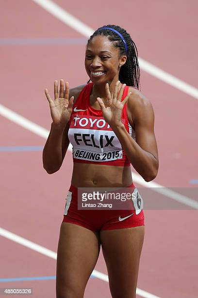 Allyson Felix of the United States reacts after competing in the Women's 400 metres heats during day three of the 15th IAAF World Athletics...