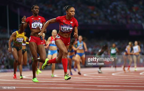 Allyson Felix of the United States receives the relay baton fom DeeDee Trotter of the United States during the Women's 4 x 400m Relay Final on Day 15...