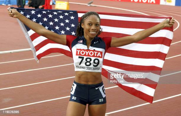 Allyson Felix of the United States takes a victory lap with an American flag after winning the women's 200 meters in 2216 in the IAAF World...