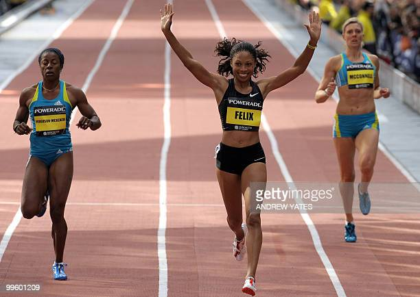 Allyson Felix of the US celebrates as she wins the womens 200m hurdles as Lee McConnell of Britain and Debbie FergusonMckenzie during the Great city...