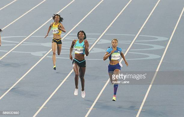 Allyson Felix of United States battle the line with Shaunae Miller of Bahamas during the semifinal Athletics Women's 400m at Olympic Stadium on...