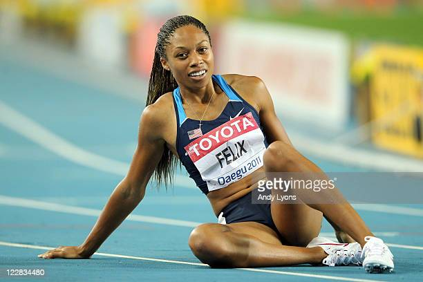 Allyson Felix of United States recovers after competing in the women's 400 metres final during day three of the 13th IAAF World Athletics...