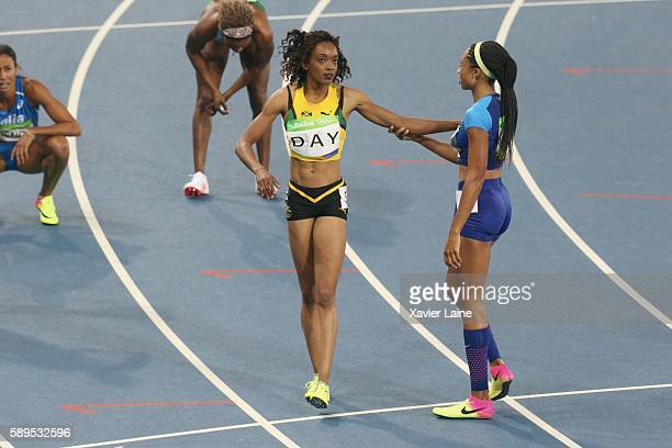 Allyson Felix of United Statescelebrate his victory with Christine Day of Jamaica during the semifinal Athletics Women's 400m at Olympic Stadium on...