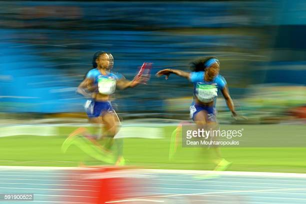 Allyson Felix passes the baton to English Gardner of the United States during the round one Women's 4 x 100m Relay ReRun on Day 13 of the Rio 2016...