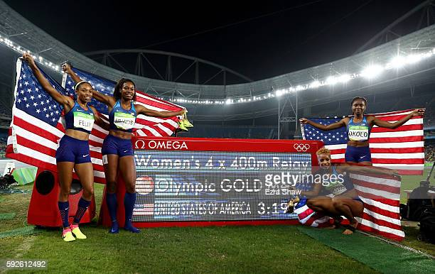 Allyson Felix Phyllis Francis Natasha Hastings and Courtney Okolo of the United States pose for a photo after winning gold in the Women's 4 x 400...