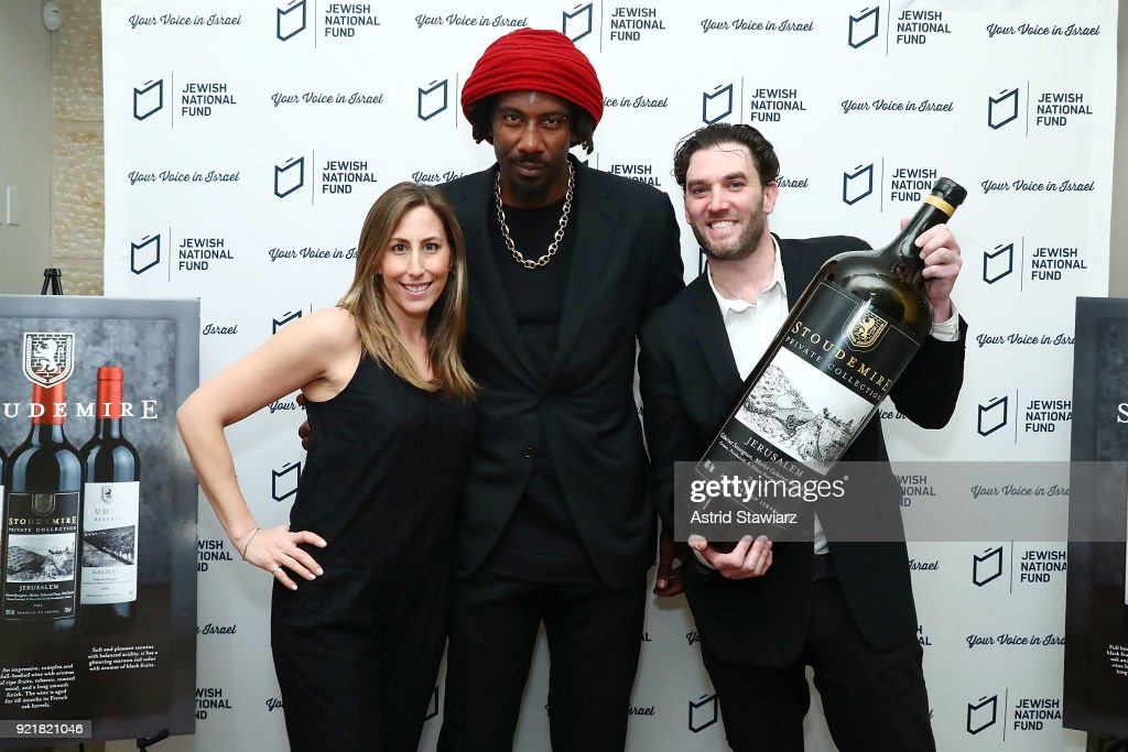 Allyson Greenstein, basketball player Amar'e Stoudemire and VP of Sales & Marketing for the Israeli Wine Producers Association, Joshua Greenstein pose for photos during 'Stoudemire Wines' launch reception with the Jewish National Fund at Ronald S. Lauder JNF House on February 20, 2018 in New York City.