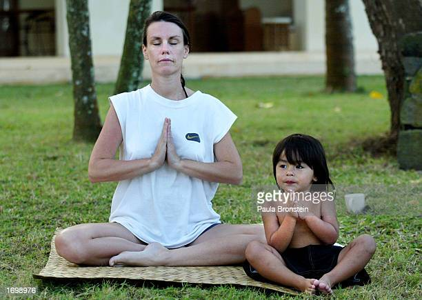Allyson PulsDharmadji and her 2yearold son Kier take part in the afternoon yoga class at the Serai Hotel July 31 2002 in Manggis Bali Indonesia