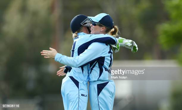 Allyssa Healy and Alex Blackwell of NSW embrace after winning the WNCL Final match between New South Wales and Western Australia at Blacktown...