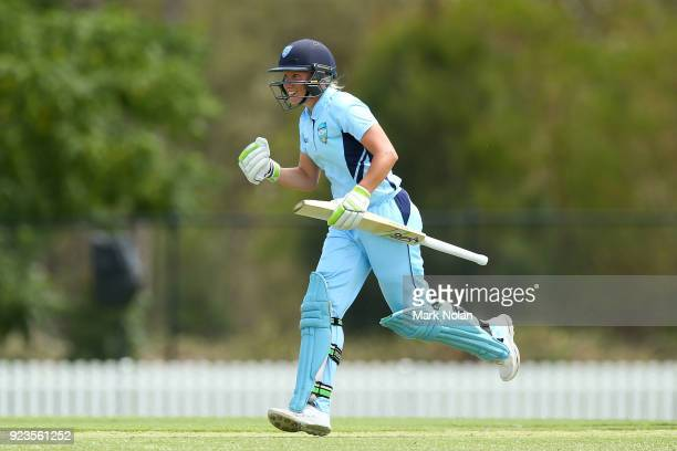 Allyssa Healy of NSW celebrates scoring a century during the WNCL Final match between New South Wales and Western Australia at Blacktown...