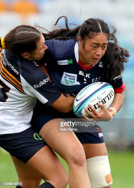 Allyssa Lolesio-Pua of the Rebels runs with the ball during the Super W match between the Melbourne Rebels and the ACT Brumbies at Coffs Harbour...