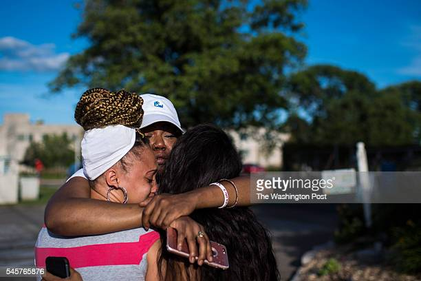 Allysza Castile the younger sister of Philando Castile center is hugged by her best friends near a roadside vigil where Castile was fatally shot in...