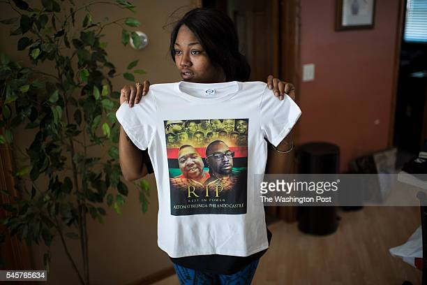 Allysza Castile the younger sister of Philando Castile shows off a shirt she was given at her home in Minneapolis Minn on Saturday July 09 2016...