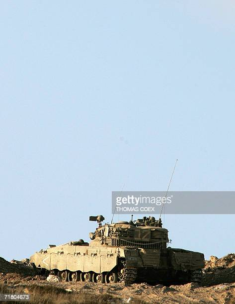 An Israeli tank stands guard at a position on a hill near the southern Lebanese village of Alma alShaab 07 September 2006 Israel lifted its punishing...