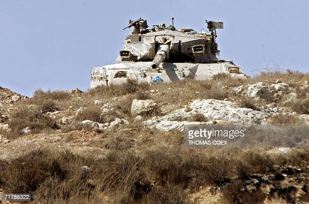 An Israeli tank takes position on the top of a hill near the southern Lebanese border village of Alma alShaab 05 September 2006 UN Secretary General...