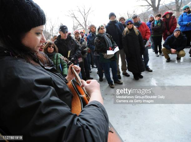 Alma Collins plays and sings to people who gathered in the Central Park bandshell to honor the fallen homeless in 2013 Boulder Bridge House and the...