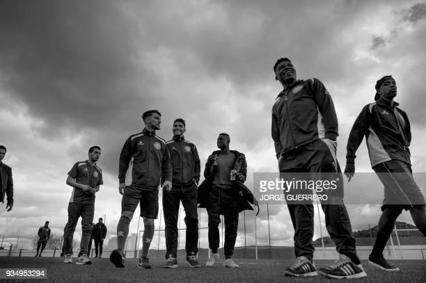 Alma de Africa Union Deportiva players arrive at the Espera CF stadium before a football match against Espera CF in Espera on March 18 2018 / STORY...