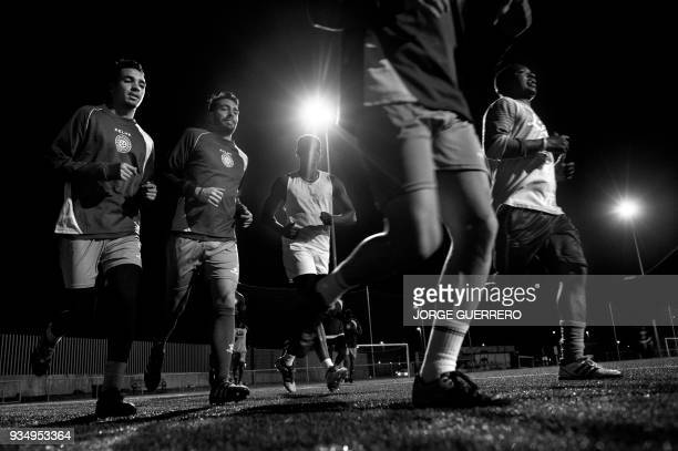 Alma de Africa Union Deportiva players attend a training session at the San Telmo Sport Complex in Jerez de la Frontera on March 9 2018 / STORY...
