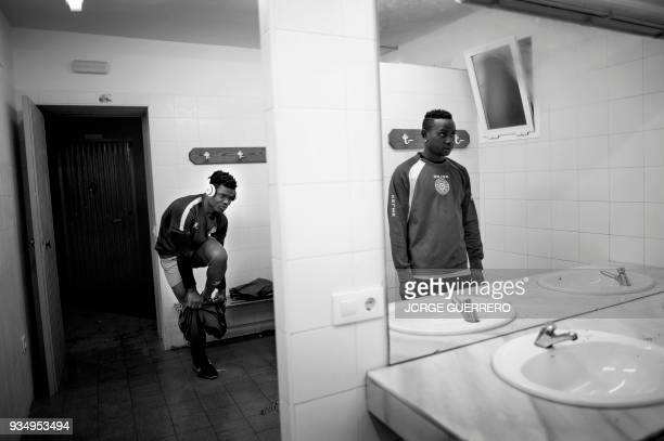 Alma de Africa Union Deportiva players' Christian Tchikagoua and Khadimour Rassoul Mbaye prepare for a training session at the San Telmo Sport...