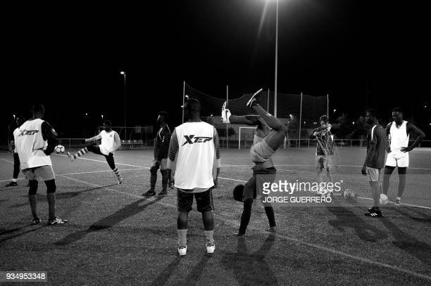 Alma de Africa Union Deportiva players take part in a training session at the San Telmo Sport Complex in Jerez de la Frontera on March 9 2018 / STORY...