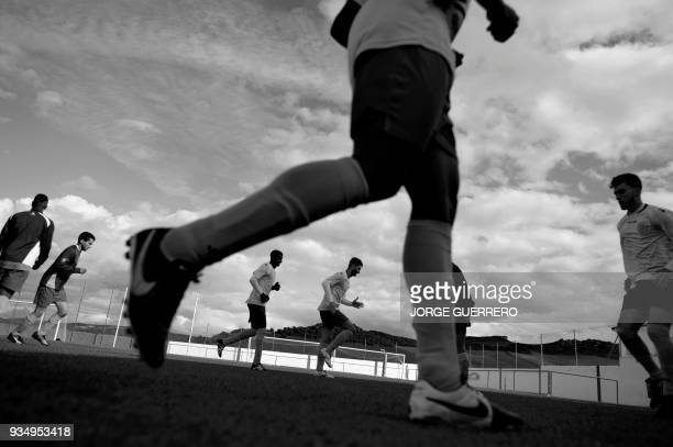 Alma de Africa Union Deportiva players warm up before their football match against Espera CF in Espera on March 18 2018 / STORY 'Sporting glory in...