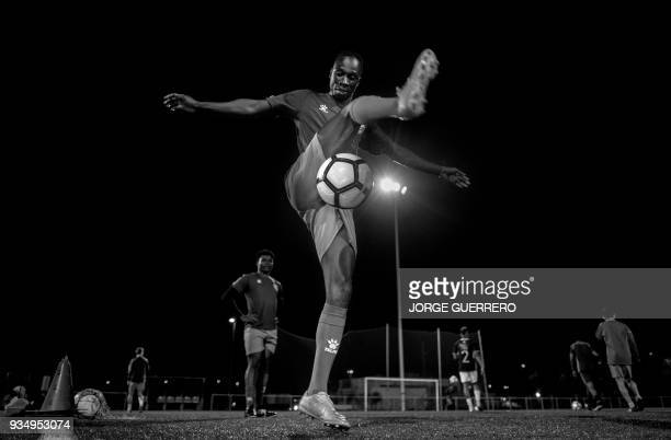 TOPSHOT Alma de Africa Union Deportiva's BissauGuinean player Pedro controls the ball during a training session at the San Telmo Sport Complex in...