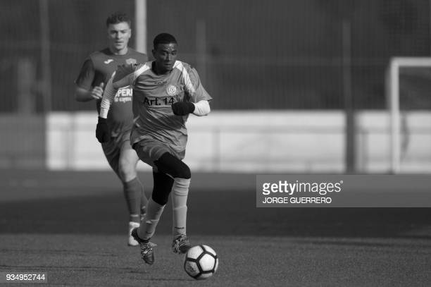 Alma de Africa Union Deportiva's Cameroonian player Karim Issa Abdou controls the ball during a football match against Espera CF in Espera on March...