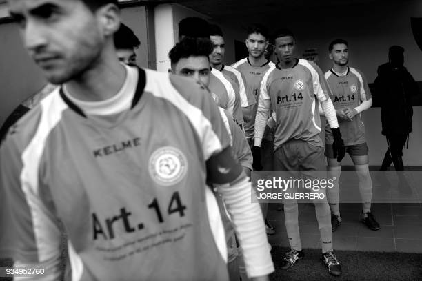 Alma de Africa Union Deportiva's Cameroonian player Karim Issa Abdou and teammates wait for the start of the football match against Espera CF in...