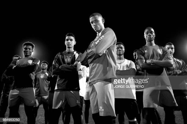 Alma de Africa Union Deportiva's Cameroonian player Karim Issa Abdou poses with teammates after a training session at the San Telmo Sport Complex in...
