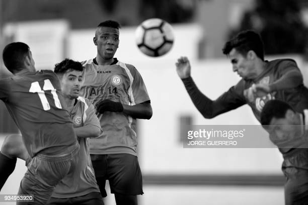 Alma de Africa Union Deportiva's forward Abdul eyes the ball during a football match against Espera CF in Espera on March 18 2018 / STORY 'Sporting...
