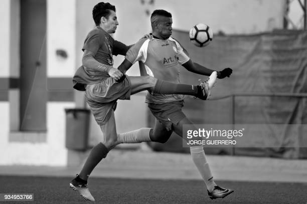 Alma de Africa Union Deportiva's forward Abdul vies with a Espera CF player during a football match in Espera on March 18 2018 / STORY 'Sporting...