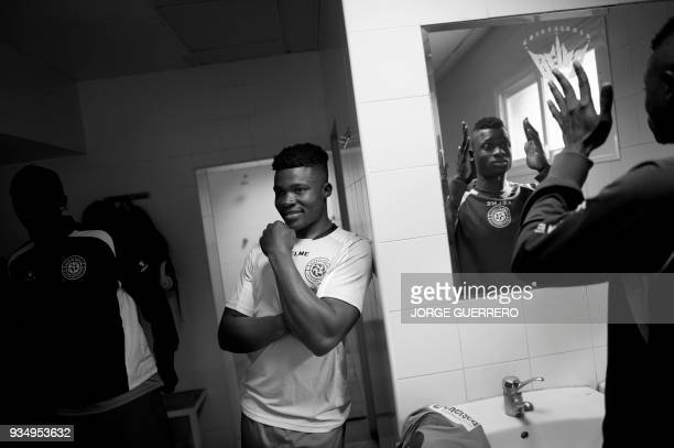 Alma de Africa Union Deportiva's player Christian Tchikagoua smiles before a football match against Espera CF in Espera on March 18 2018 / STORY...