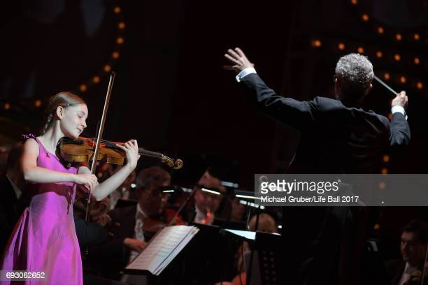 Alma Deutscher and conductor Alfred Eschwe perform on stage during the Life Celebration Concert at Burgtheater on June 6 2017 in Vienna Austria The...