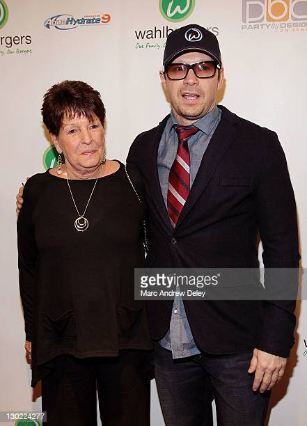 Alma Elaine Wahlberg and her son Donnie Wahlberg attend the grand opening of Wahlburgers on October 24 2011 at the Hingham Shipyard in Boston...