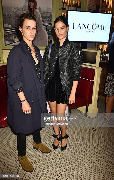 Alma Jodorowsky and Agathe Mougin attend the Caroline de Maigret for Lancôme Cocktail Party at Cherche Midi at Cherche Midi on September 9 2014 in...