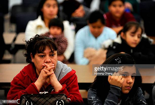 Alma Meraz front left and her daughter Christian Rojas are praying for the winning of the lottery of West Denver Prep a small network of...