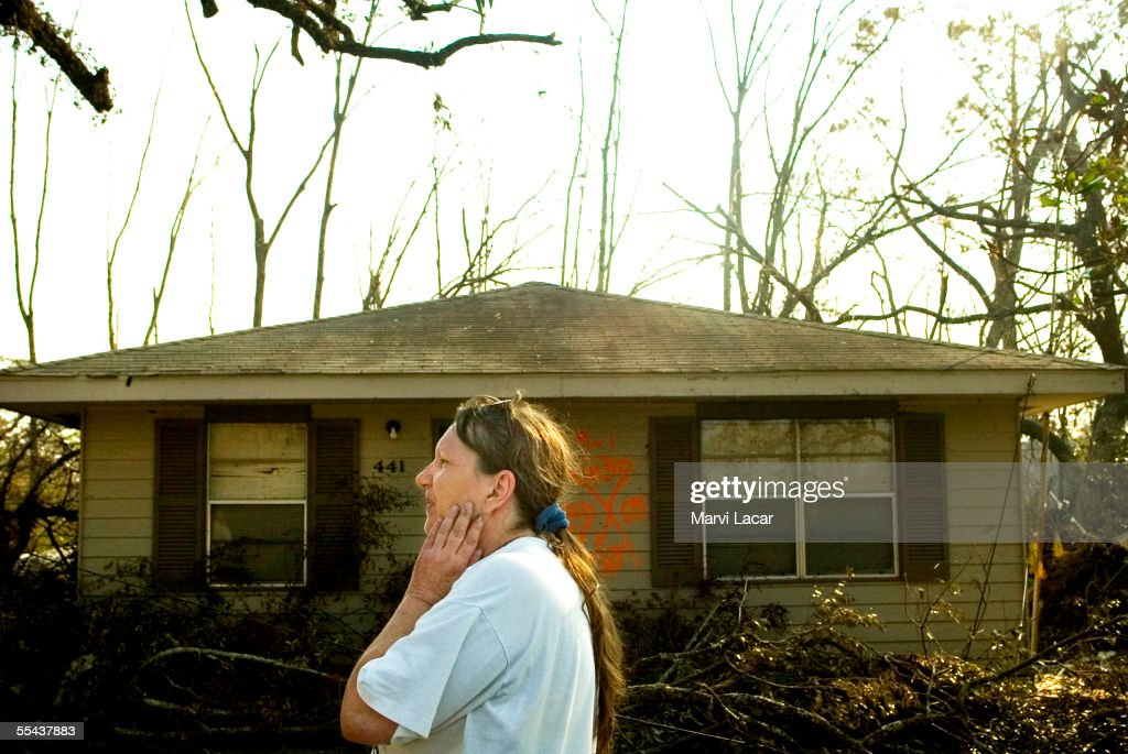 Alma Phillips examines the remains of her house on 441 Waveland Ave. on September 3, 2005 in Waveland, Mississippi. Hurricane Katrina's category 5 strength left the coast of Florida, Alabama, Mississippi and Louisina in ruins. Mississippi confirmed death toll was over 120 by Thursday as more rescue teams combed the devasted areas.