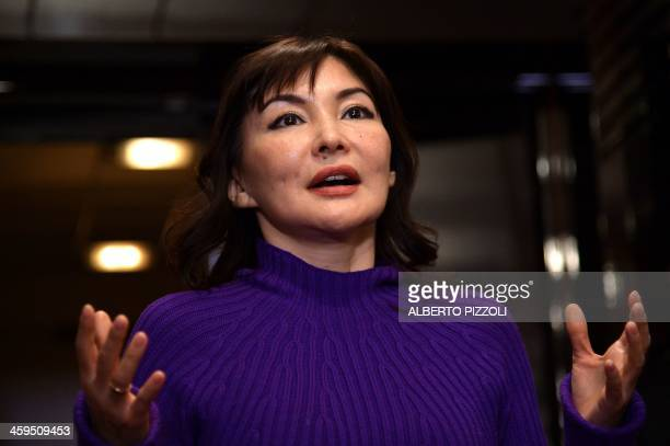Alma Shalabayeva gestures during a press conference after she arrived in Rome on December 27 2013 Shalabayeva the wife of a Kazakh tycoon and their...