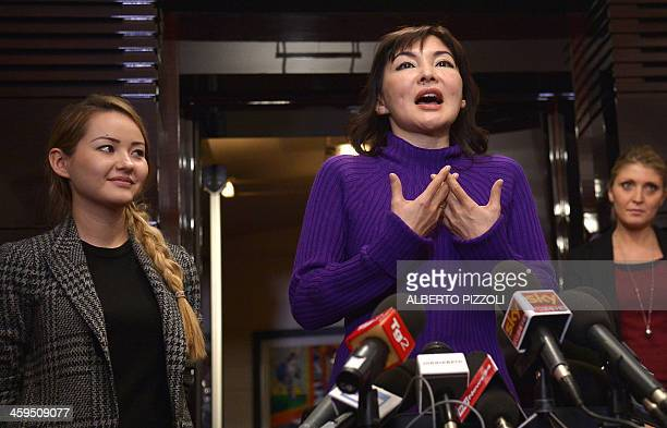 Alma Shalabayeva gestures during a press conference flanked by her daughter Madina after she arrived in Rome on December 27 2013 Shalabayeva the wife...